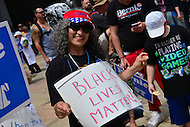 """Philadelphia, PA - July 26, 2016: Noiree Krikorian, or Seatle, Washington, holds a """"Black Lives Matter"""" sign at a """"Bernie or Bust"""" rally across from City Hall during the Democratic National Convention in Philadelphia, PA, July 26, 2016  (Photo by Don Baxter/Media Images International)"""