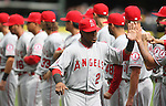 Los Angeles Angels Albert Pujols (2) high five teammates during introductions before their game against the Seattle Mariners in  season home opener April 6, 2015 at Safeco Field in Seattle.  The Mariners beat the Angels 4-1.