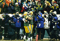 Andre Rison celebrates with Antonio Freeman after Freeman caught a touchdown pass in the NFC Divisional Playoffs against the San Francisco 49ers at Lambeau Field on January 4, 1997. The Packers won the contest 35-14.