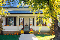 Country home with porch decorated for fall and halloween and the annual celebration of the pumpkins festival