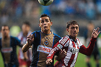 Leo Fernandes (22) of the Philadelphia Union and Marco Delgado (12) of CD Chivas USA. The Philadelphia Union defeated the CD Chivas USA 3-1 during a Major League Soccer (MLS) match at PPL Park in Chester, PA, on July 12, 2013.