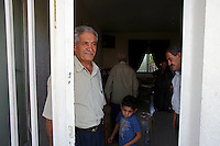 "Rmadiyeh, south Lebanon, Aug 1 2006.The Burji, Adibi and Nasser families are sharing ressources in a single big house, about 80 inhabitants from this small village  have decided to remain home in spite of Israel's continuous bombardments and shellings for the last 3 weeks, mainly ""because they have nowhere else to go""."