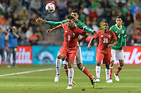 Bridgeview, IL, USA - Tuesday, October 11, 2016: Panama forward Rolando Blackburn (9) and Mexico defender Jordan Silva (21) compete for a ball during an international friendly soccer match between Mexico and Panama at Toyota Park. Mexico won 1-0.