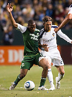 Portland Timbers defender Mamadou Danso (98) battles David Beckham (23) of the LA Galaxy for a loose ball.The LA Galaxy defeated the Portland Timbers 3-0 at Home Depot Center stadium in Carson, California on  April  23, 2011....
