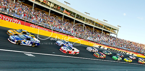 Photo: NASCAR race cars sit lined on the track for the start of the 2012 Coca-Cola 600 race at the Charlotte Motor Speedway.