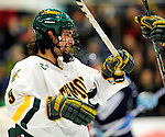 29 January 2010: University of Vermont Catamount forward Wahsontiio Stacey, a Junior from Kahnawake, Quebec, celebrates a second period goal against the University of Maine Black Bears at Gutterson Fieldhouse in Burlington, Vermont. The Black Bears defeated the Catamounts 6-3 in the first game of their America East weekend series. Mandatory Credit: Ed Wolfstein Photo