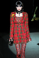 Anna walks runway in a Savin' All My Love 4 U outfit, from the Betsey Johnson Fall 2011 He Loves Me Not - Black Tag collection, during Mercedes-Benz Fashion Week Fall 2011.