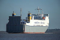 On the River Thames the Melusine, a Ro-Ro cargo ferry from the Cobelfret Ferries Line steams downriver.