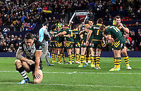 Picture by Vaughn Ridley/SWpix.com - 30/11/2013 - Rugby League - 2013 Rugby League World Cup Final - New Zealand v Australia - Old Trafford, Manchester, England - New Zealand's Sonny Bill Williams looks on as Australia celebrate victory.