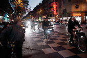 Paris, France.November 16, 2007..Commuters at Boulevard Sebastopol struggle with public transportation by riding bicycles (often the new public Velib bicycles) at rush hour along side cars, trucks, motorcycles and scouters. The French public transport unions (SNCF, RATP) remained on strike for the third day in a major test for President Nicolas Sarkozy's reforms. They are protesting against the scrapping of pension privileges that allow some public employees to retire as early as age 50...