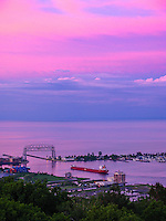 &quot;Duluth Harbor Under a Pink Sky&quot;<br /> <br /> Viewed from Enger Tower on a summer evening, a ship departs the Duluth Harbor under a pink sky.