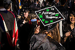 A student sports one of the many decorated mortar boards seen at commencement on Saturday, May 2, 2015.  Photo by Ohio University  /  Rob Hardin