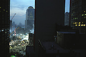 Workers work into the night to search for remains of bodies of the victims and to clear the smouldering remains of the World Trade Centre complex, in lower Manhattan, destroyed on September 11th 2001 by AL-Qaeda terrorists. New York, America.