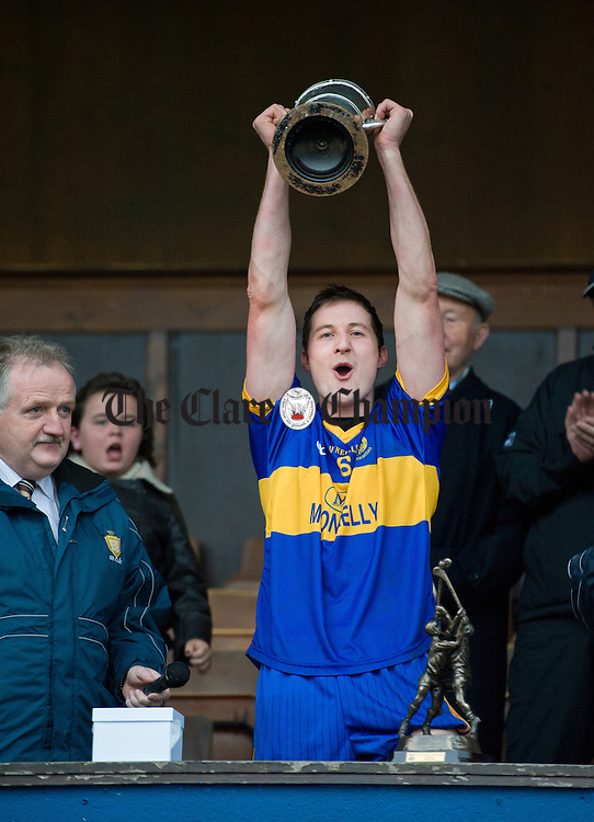 Newmarket captain Enda Barrett lifts the cup following their senior county hurling final win over Cratloe at Cusack Park. Photograph by John Kelly.