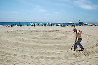 Dean Pollard builds a sand Labyrinth at Santa Monica Beach in honor of the summer soulstice on Tuesday, June, 21, 2011. A labyrinth is an ancient symbol dating back 3500 years. Labyrinths have long been used as meditation and prayer tools. A labyrinth has only one path. It is unicursal. The way in is the way out. There are no blind alleys. The path leads you on a circuitous path to the center and out again.