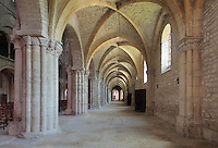 South side aisle, with low rib vaulted ceiling and windows, in the Basilique Saint Remi or Abbey of St Remi, Reims, France. The 11th century, mainly Romanesque, church, contains the relics of St Remi, the Bishop of Reims, who converted Clovis, the King of the Franks, to Christianity in 496 AD. The abbey is a UNESCO World Heritage Site. Picture by Manuel Cohen