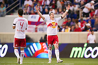 Kenny Cooper (33) of the New York Red Bulls celebrates scoring during the first half against the San Jose Earthquakes during a Major League Soccer (MLS) match at Red Bull Arena in Harrison, NJ, on April 14, 2012.
