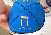 Hillary HEY Blue Yarmulke shown by Marc Daniels of Springfield, Illinois, who sells Jewish Campaign Kippahs (yarmulkes) on Euclid Avenue near the Quicken Loans Arena, site of the 2016 Republican National Convention in Cleveland, Ohio on Saturday, July 16, 2016.<br /> Credit: Ron Sachs / CNP<br /> (RESTRICTION: NO New York or New Jersey Newspapers or newspapers within a 75 mile radius of New York City)