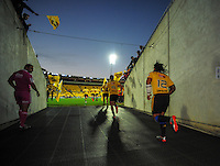 The Hurricanes run out for the Super Rugby match between the Hurricanes and Rebels at Westpac Stadium, Wellington, New Zealand on Friday, 13 March 2015. Photo: Dave Lintott / lintottphoto.co.nz