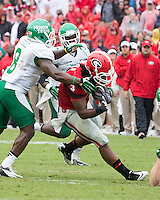 The Georgia Bulldogs played North Texas Mean Green at Sanford Stadium.  After North Texas tied the game at 21 early in the second half, the Georgia Bulldogs went on to score 24 unanswered points to win 45-21.  North Texas Mean Green defensive back Marcus Trice (8), Georgia Bulldogs running back Todd Gurley (3)