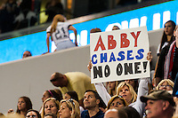 "A fan holds up a sign reading ""Abby chases no one"". The women's national team of the United States defeated the Korea Republic 5-0 during an international friendly at Red Bull Arena in Harrison, NJ, on June 20, 2013."