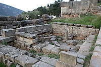 DELPHI, GREECE - APRIL 12 : A general view of the Sicyonian Treasury on April 12th, 2007, in the Sanctuary of Apollo, Delphi, Greece. The Treasury of Sicyon was built in the 6th century BC, circa 525 BC in the Ionic order. It is notable for remains of older Doric structures re-used in its foundations. (Photo by Manuel Cohen)