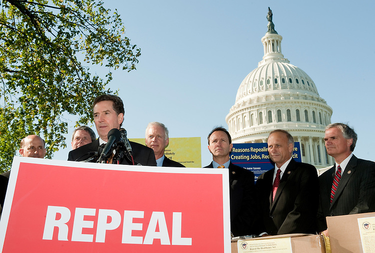 UNITED STATES - OCTOBER 5: Sen. Jim DeMint, R-S.C., speaks during a news conference at the Capitol on Wednesday, Oct. 5, 2011, to accept over 1.6 million petitions from American citizens who are urging Congress to immediately repeal Patient Protection and Affordable Care Act. In the background from left are Rep. Louie Gohmert, R-Texas, Sen. David Vitter, R-La., Sen. Ron Johnson, R-Wisc., Rep. Jeff Landry, R-La., Rep. Steve King, R-Iowa, and Rep. Robert Latta, R-Ohio. (Photo By Bill Clark/CQ Roll Call)