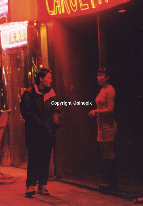 A man approaches a prostitute in Beijing. As the gender imbalance grows more and more men are using prostitutes and sex aids, doubtful that they ever find a wife. An average gender inbalance 118 males to 100 females caused by the Chinese Governments One Child Policy and the  preference for boys means that there is a shortage of women in China.