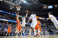 Alex Oriakhi of the Huskies shots a short one-handed jumper. Connecticut defeated Bucknell 81-52 during the NCAA tournament at the Verizon Center in Washington, D.C. on Thursday, March 17, 2011. Alan P. Santos/DC Sports Box