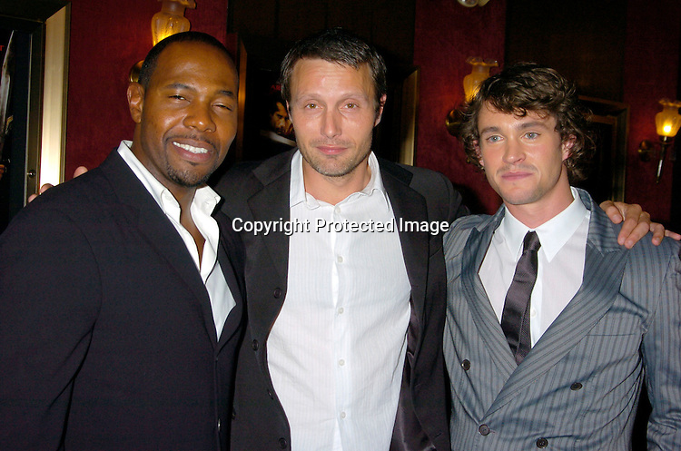 "Director Antoine Fuqua, Mads Mikkelson and Hugh Dancy ..at the World Premiere of ""King Arthur"" on June 28, 2004 at ..the Ziegfeld Theatre. ..Photo by Robin Platzer, Twin Images"