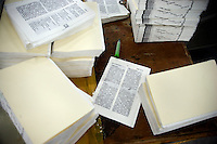 "Pages of Chinese-language Bibles sit on a binding table in the Amity Printing Company's new printing facility in Nanjing, China....On May 18, 2008, the Amity Printing Company in Nanjing, Jiangsu Province, China, inaugurated its new printing facility in southern Nanjing.  The facility doubles the printing capacity of the company, now up to 12 million Bibles produced in a year, making Amity Printing Company the largest producer of Bibles in the world.  The company, in cooperation with the international organization the United Bible Societies, produces Bibles for both domestic Chinese use and international distribution.  The company's Bibles are printed in Chinese and many other languages.  Within China, the Bibles are distributed both to registered and unregistered Christians who worship in illegal ""house churches."""