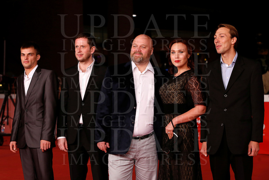 Il regista russo Aleksey Fedorchenko, al centro, con gli attori, da sinistra, Alexei Solonchev, Pavel Basov, Daria Ekamasova e Konstantin Balakirev sul red carpet per la presentazione del suo film &quot;Angeli della rivoluzione&quot; al Festival Internazionale del Film di Roma, 22 ottobre 2014.<br /> Russian director Aleksey Fedorchenko, center, poses with actors, from left, Alexei Solonchev, Pavel Basov, Daria Ekamasova and Konstantin Balakirev on the red carpet for the screening of his movie &quot;Angely Revolucii&quot; (&quot;Angels of Revolution&quot;) during the international Rome Film Festival at Rome's Auditorium, 22 October 2014.<br /> UPDATE IMAGES PRESS/Riccardo De Luca