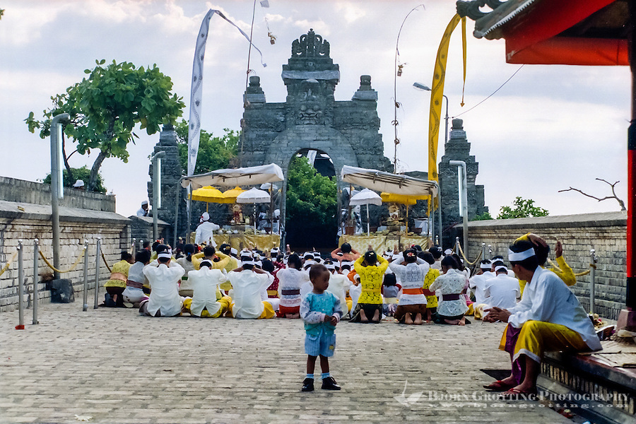 Bali, Badung, Uluwatu. A hindu ceremony. This fellow is a bit too young to take part in the praying.
