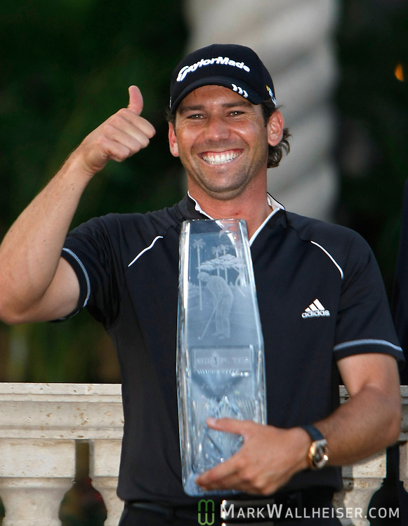 Sergio Garcia, from Castellon, Spain gives a thumbs up with the trophy after winning The Players Championship PGA golf tournament in Ponte Vedra Beach, Florida on May 11, 2008.  (Mark Wallheiser/TallahasseeStock.com)