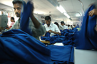 Men at work at Srinidhi Industry's garment stitching factory in Tirupur, Tamilnadu. After lifting of quota system in textile export on 1st january 2005. Tirupur has become the biggest foreign currency earning town of India.
