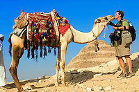 Photographer Blaine Harrington bonds with the camels at Step Pyramid of King Zoser, Saqqara, Egypt