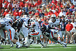 Ole Miss linebacker Serderius Bryant (14) tackles Auburn running back Onterio McCalebb (23) at Vaught-Hemingway Stadium in Oxford, Miss. on Saturday, October 13, 2012. (AP Photo/Oxford Eagle, Bruce Newman)..