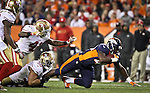 SHOT 10/19/14 7:40:51 PM - Denver Broncos running back Juwan Thompson #40 tries to fight through the tackle of San Francisco 49ers linebacker Chris Borland #50 at Sports Authority Field at Mile High Sunday October 19, 2014 in Denver, Co. The Broncos beat the 49ers 42-17.<br /> (Photo by Marc Piscotty / &copy; 2014)