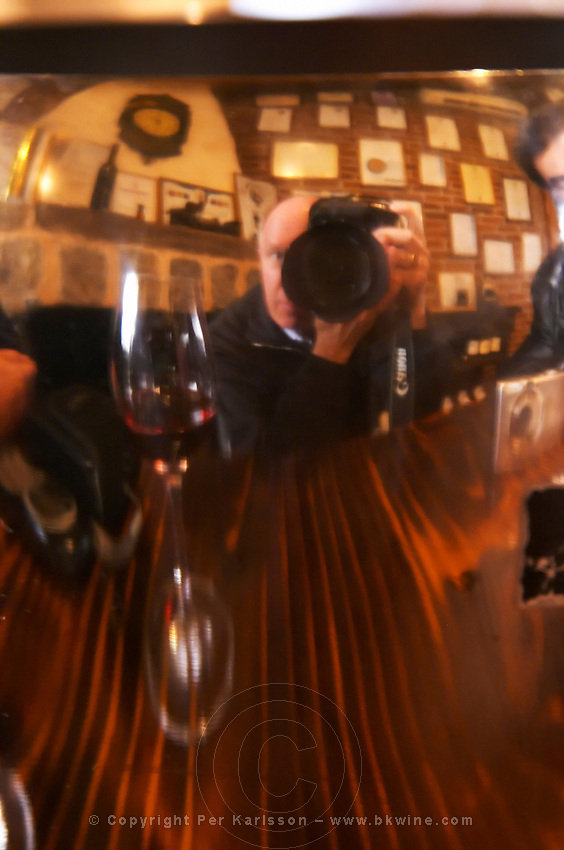 Self-portrait of the photographer with a wine glass reflected in an ice-bucket. Bodega Vinos Finos H Stagnari Winery, La Puebla, La Paz, Canelones, Montevideo, Uruguay, South America
