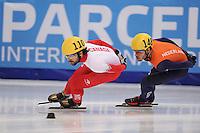"SHORT TRACK: MOSCOW: Speed Skating Centre ""Krylatskoe"", 15-03-2015, ISU World Short Track Speed Skating Championships 2015, Semifinals 1000m Men, Charles HAMELIN (#110   CAN), Sjinkie KNEGT (#148   NED), ©photo Martin de Jong"