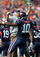 Virginia head coach Al Groh bumps chests with quarterback Jameel Sewell after scoring the 1st touchdown against Miami Saturday November 18, 2006 at Scott Stadium in Charlottesville, Va. Photo/The Daily Progress/Andrew Shurtleff