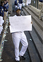 "04 October 2009: Seattle Mariners designated hitter Ken Griffey Jr holds up a sign for the TV camera saying ""I've been here all year!!! Where are my Rally Fries??? during the game against Texas. Seattle won 4-3 over the Texas Rangers at Safeco Field in Seattle, Washington."