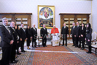 Pope Benedict XVI and German President Joachim Gauck exchange gifts during a private audience on December 6, 2012 in the pontif's library at the Vatican