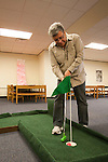 Jesús Esparza putts a golf ball into the hole during the Alden Open, a Dad's Weekend Mini-Golf event in Alden Library, on Saturday, November 7, 2015. Photo by Kaitlin Owens