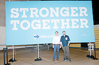 "Stern writer Norbert Hoefler (in white) and photographer M. Scott Brauer pose for a picture with a ""Stronger Together"" sign after a campaign rally for Democratic presidential nominee Hillary Clinton in the Theodore R. Gibson Health Center at Miami Dade College-Kendall Campus in Miami, Florida, USA."