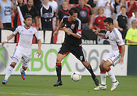 D.C. United defender Dejan Jakovic (8) goes against New England Revolution midfielder Benny Feilhaber (22) right and midfielder Lee Nguyen (24) left.  D.C. United defeated The New England Revolution 3-2 at RFK Stadium, Saturday May 26, 2012.