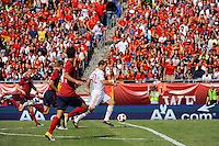 Alvaro Negredo (22) of Spain gets behind the United States defense moments before scoring. The men's national team of Spain (ESP) defeated the United States (USA) 4-0 during a International friendly at Gillette Stadium in Foxborough, MA, on June 04, 2011.