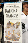 09 APR 2011: A University of Minnesota Duluth fan holds up a front page of the Duluth News Tribune after the Bulldogs won the Division I Men's Ice Hockey Championship held at the Xcel Energy Center in St. Paul, MN. Minnesota-Duluth beat Michigan in overtime, 3-2 to claim the national title. Vince Muzik/ NCAA Photos