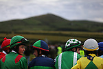 Jockeys wait for their turn to race during annual Dingle Races, the largest flapper races in Ireland, during the first day of the weekend-long event in Dingle, Ireland.