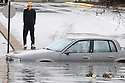 Bill Van Zant, of Bowling Green, Ky., stares at his partially submerged car after he drove into high water Thursday, Jan. 10, 2008. Heavy rains and strong winds flooded streets and downed some trees.(AP Photo/Daily News, Joe Imel)